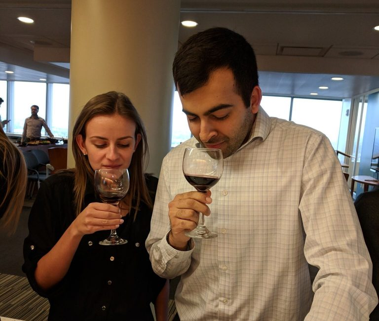 two people tasting wine at a tammy's tastings corporate event