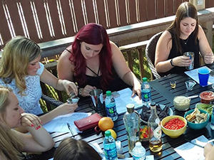 Image of four people at an outdoor Private Event -- Cocktail Class